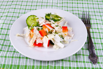 White plate with fresh vegetable salad