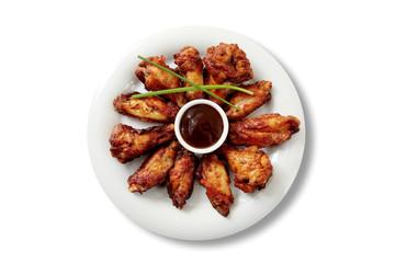 alitas de pollo y salsa barbacoa