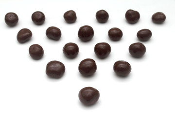Dark chocolate sweets forming a triangle