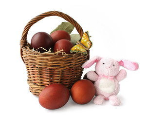Basket with Easter eggs and the rabbit