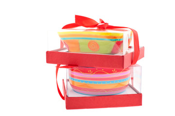 two bright colored dishes in boxes