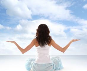 Young fit brunette meditating