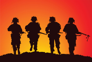 Silhouette of a small infantry group of the US Airborne