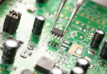 Assembling a circuit board.