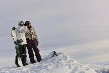 Keuken foto achterwand Wintersporten snowboarder's couple on mountain's top