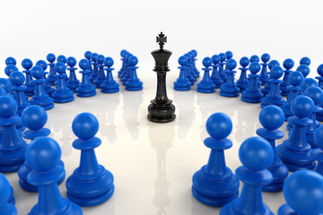 Black chess king surrounded by blue pawns
