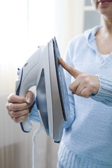 Middle Age Woman Ironing