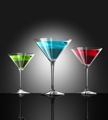 red, green and blue cocktail glasses