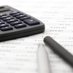 Pencil, pen and calculator close-up