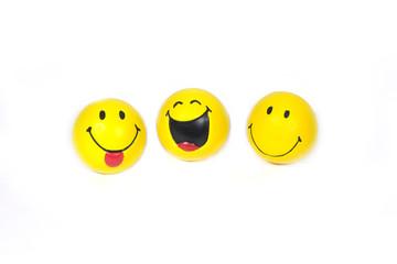 Three funny yellow smiles  isolated on white