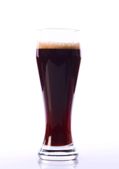 Alcohol dark beer glass with froth isolated on a white backgroun
