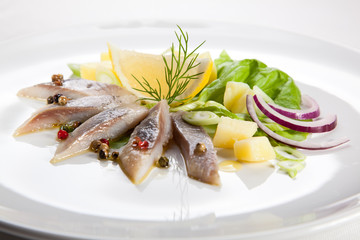 Marinated herring fillets with vegetables