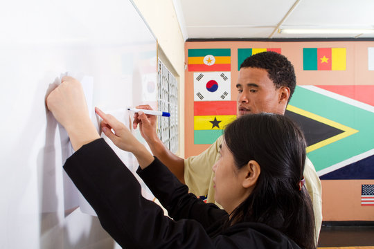 teacher teaching student chinese characters