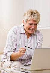 Woman using creditcard to buy internet merchandise