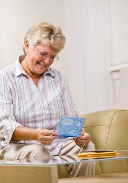 Senior woman reading note card