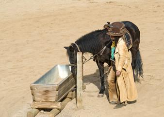 Wall Mural - Cowboy watering his horse