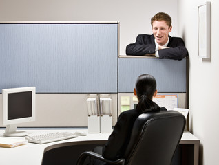 Businessman talking to co-worker