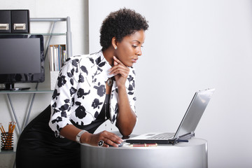 Cute executive interacts with her computer