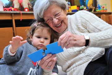 Grandmother & Granddaughter Playing at Home VII