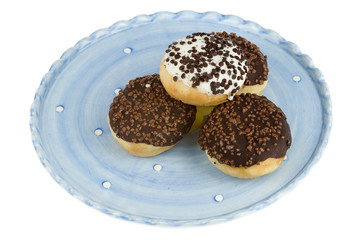 a plate with sweet donuts
