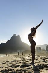 woman dancing on the  beach, Rio de Janeiro