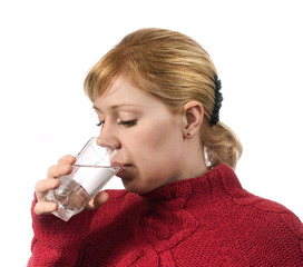 young woman drinking water from glass