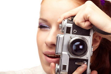 Beautiful young  woman with camera...