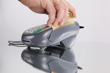 Swiping a credit or debit card through a transaction terminal