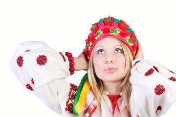 Portrait of a pretty blonde in a national cap