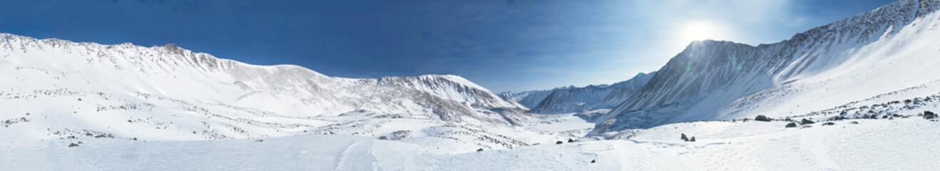 Panorama of mountains in winter. Siberia. Altai.