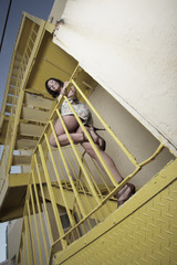 Woman posing on a staircase