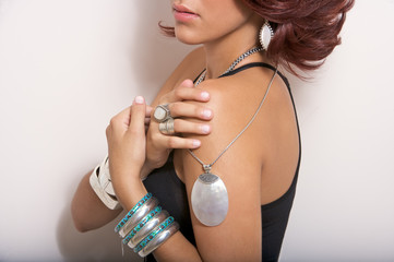 female model wearing silver jewelry earrings pendant bands
