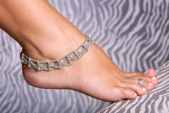 feet with silver anklet jewelry