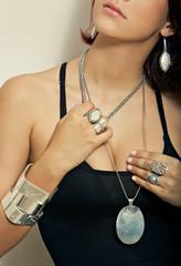 girl model wearing silver jewelry earrings necklace pendant