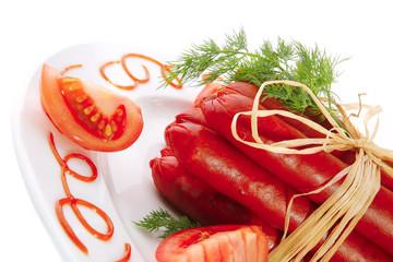fresh smoked sausages on plate