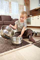 Little boy playing withcooking pots