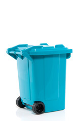 a blue recycle bin isolated over white