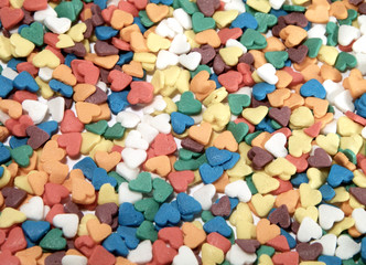 Colorful candy background in the form of hearts