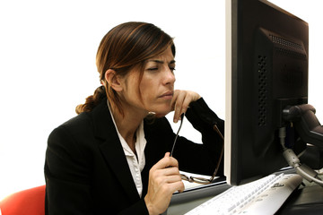 Confused businesswoman looking at her computer