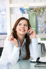 Girl on phone call in office