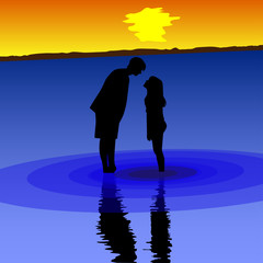 mother and child standing in the sea