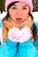 portrait of young woman with snow
