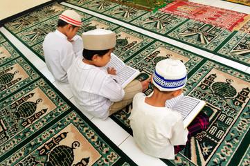 Muslim Boy Reading Koran Wall mural