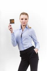 Beautiful woman holding a blank polaroid