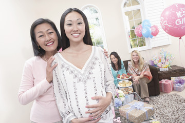mother and pregnant daughter at baby shower