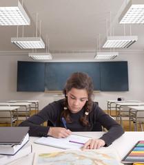 Schoolgirl working in a classroom