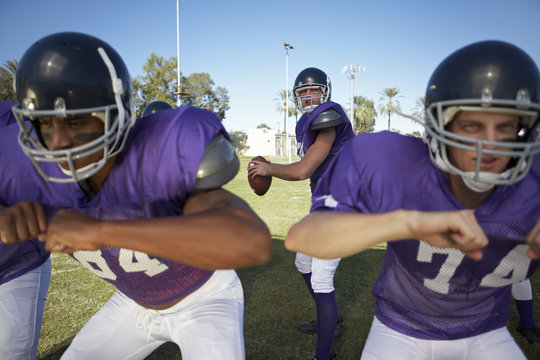 quarterback behind linemen