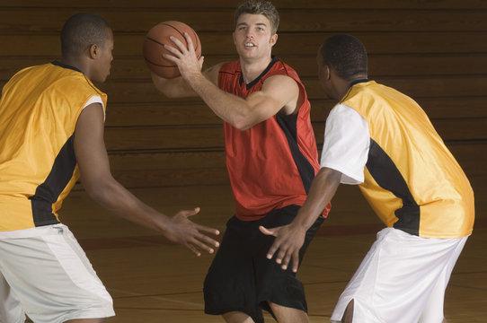 basketball match on indoor court