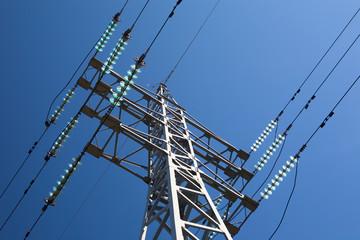 Fototapeta Metal electric pole on a blue sky background obraz