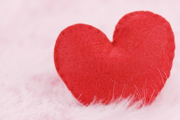 Red heart on pink  feather background